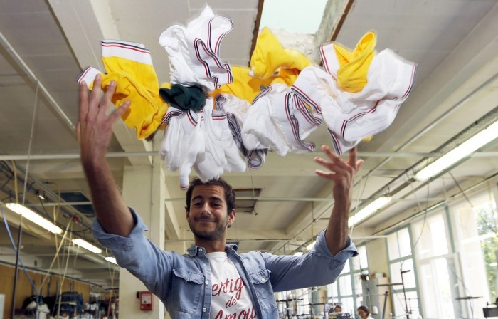 Guillaume Gibault, founder and designer of Le Slip Francais underwear brand, poses in a workshop of the Moulin Neuf textile company in Saint-Antoine-Cumond