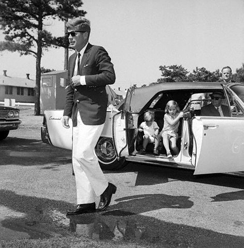 12 Aug 1963, Cape Cod, Massachusetts, USA --- President John F. Kennedy walks out of a car with his children Caroline and John Jr. following him toward a hospital where they are visiting his wife and the children's mother, Jacqueline Kennedy. --- Image by © Bettmann/CORBIS